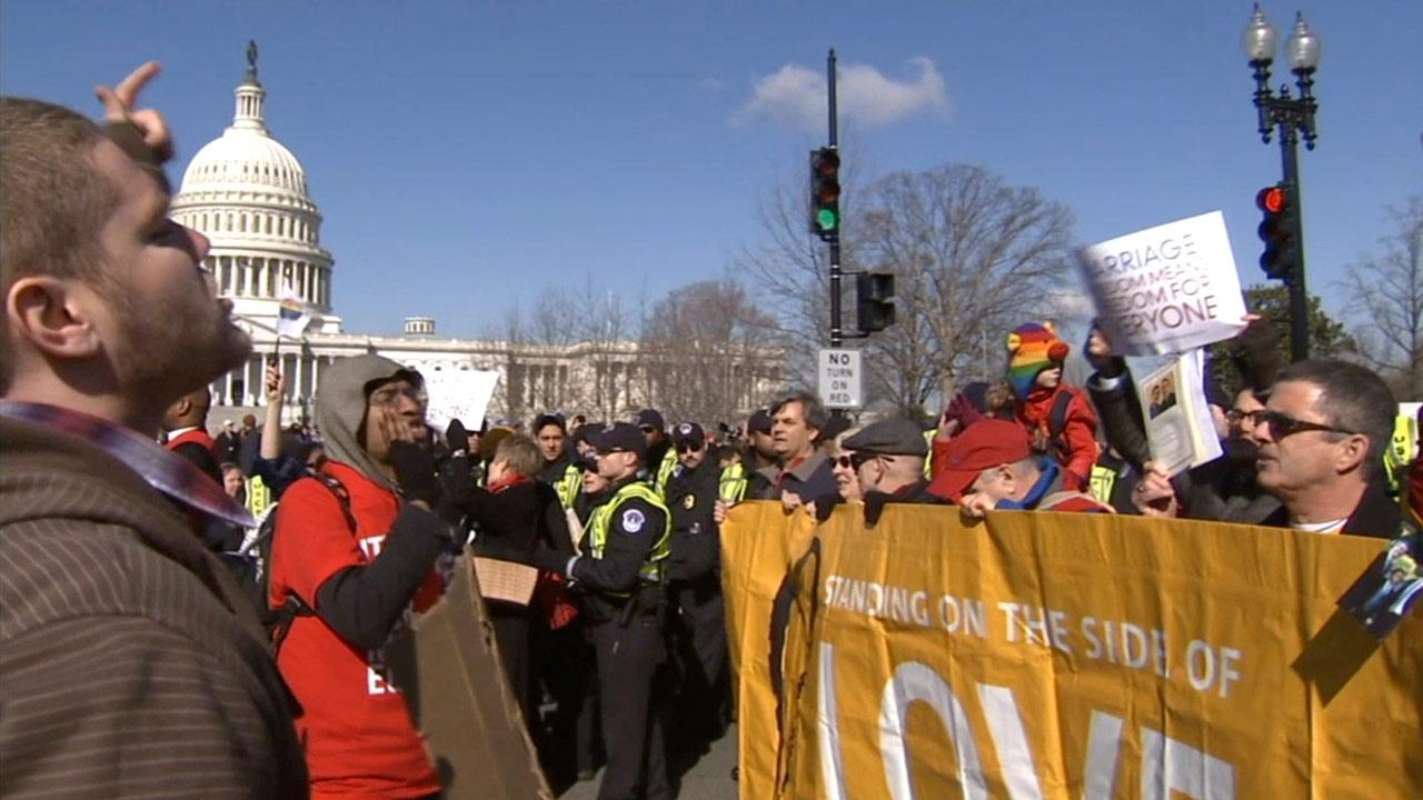 Groups for and against same-sex marriage clash outside the U.S. Supreme Court as the justices heard arguments regarding Californias ban on same-sex marriage on Tuesday, March 26, 2013.