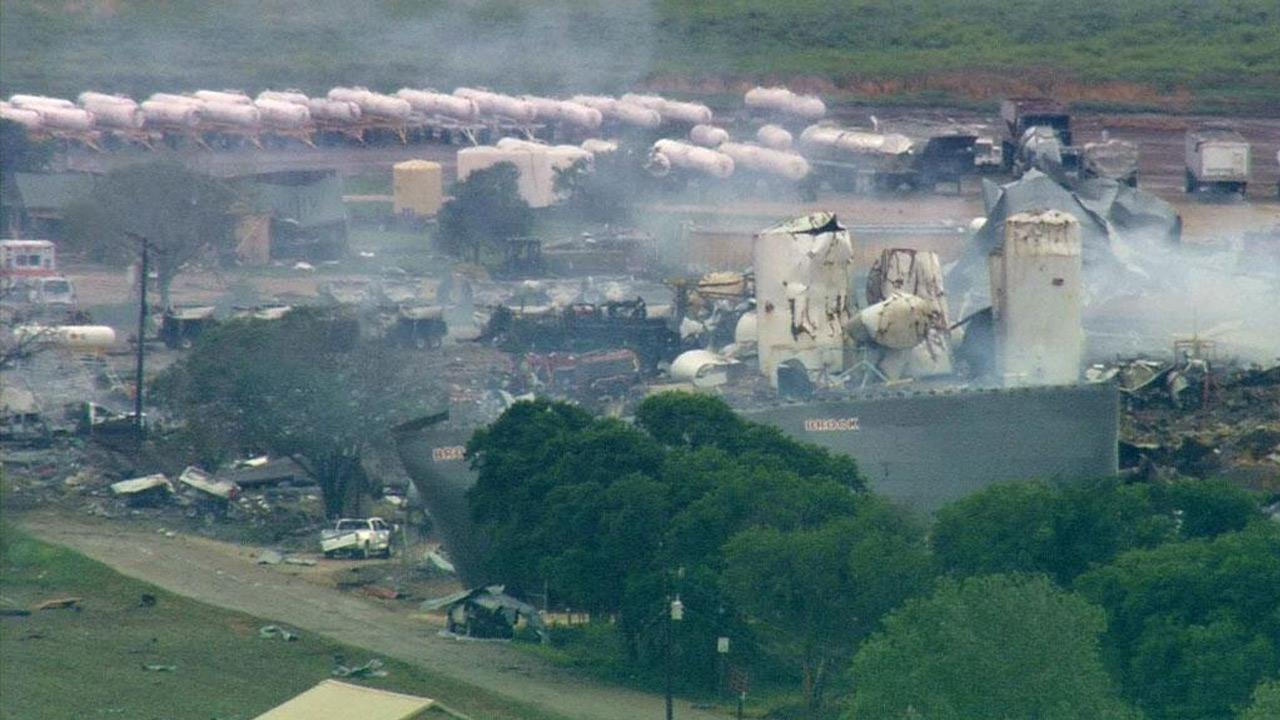 A fertilizer plant that exploded still smolders in West, Texas, Thursday, April 18, 2013. A massive explosion at the plant killed as many as 15 people and injured more than 160, officials said overnight.