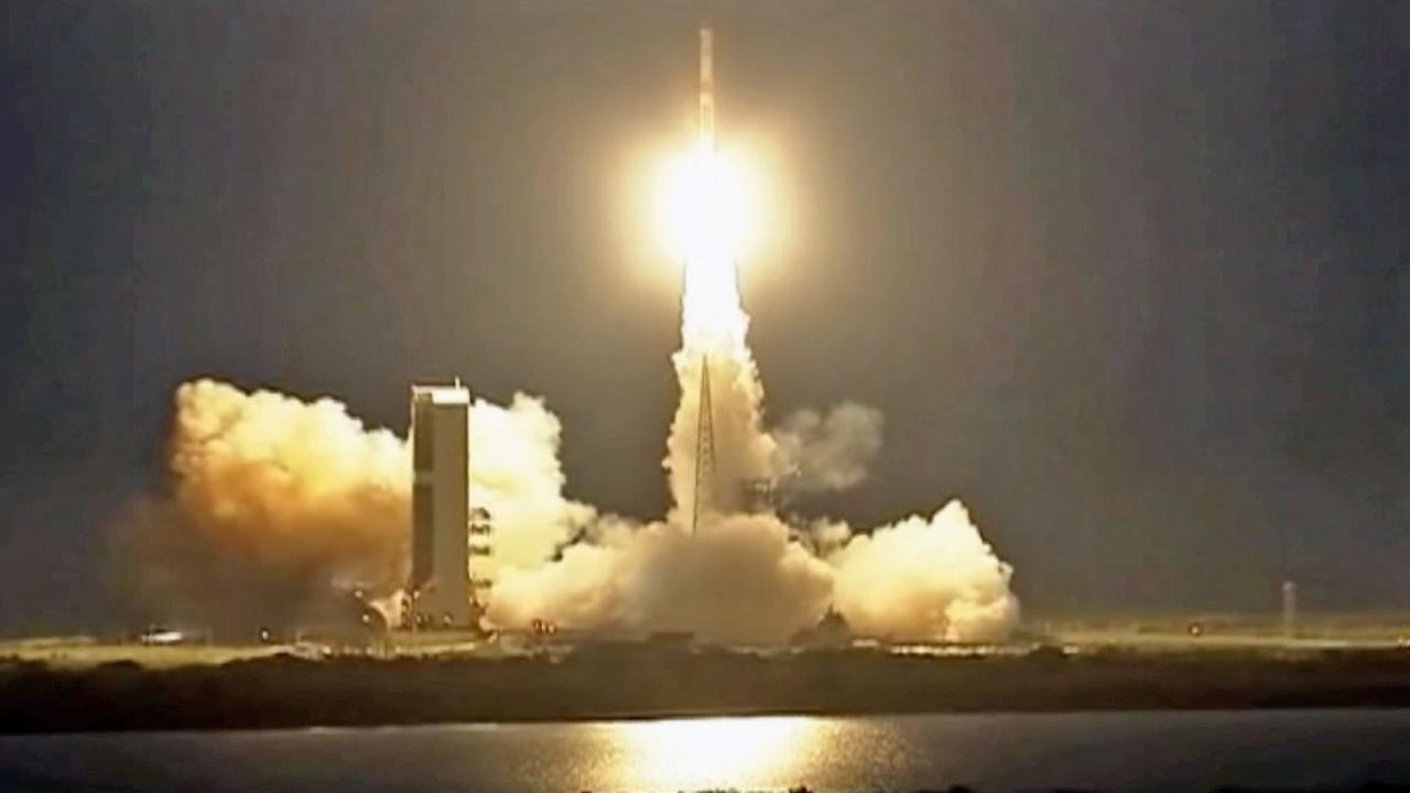 A communications satellite is seen being launched into space from Cape Canaveral Friday, May 24, 2013.