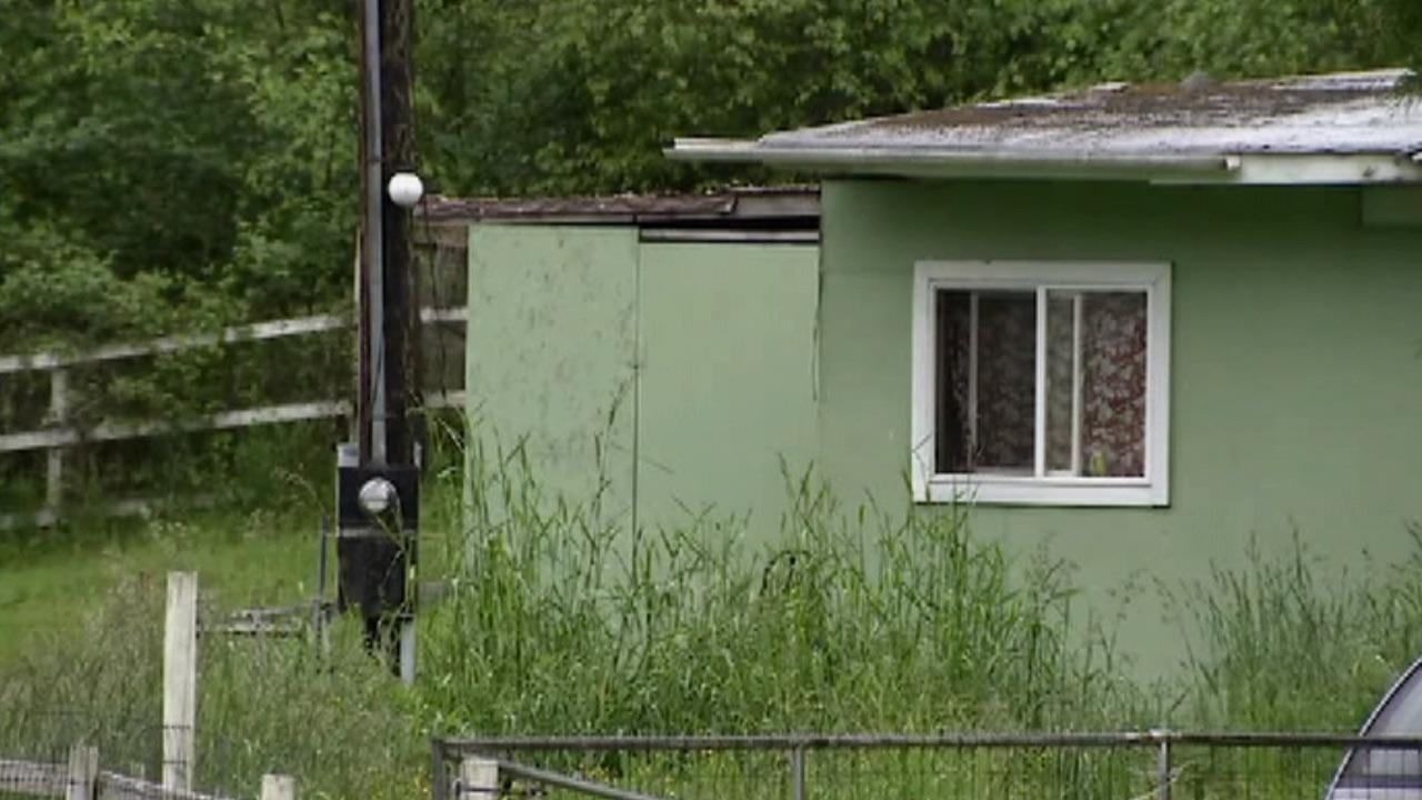 The exterior of a home is seen where a man allegedly left a baby in the freezer.