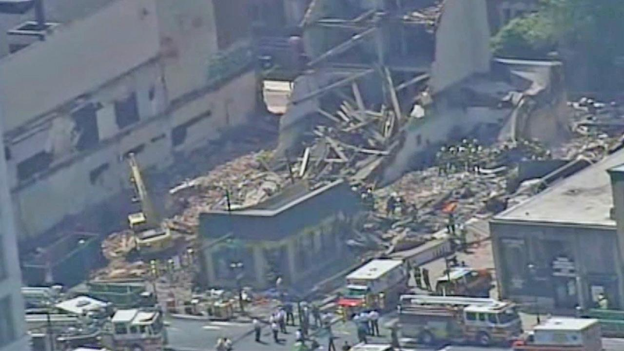 A building is seen after it collapsed onto a neighboring thrift store in Philadelphia, killing six people Wednesday, June 5, 2013.