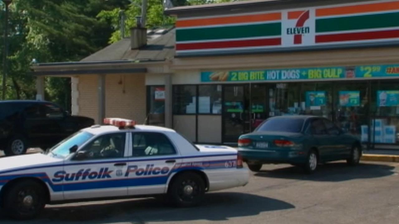 A police vehicle is seen outside a 7-Eleven in Suffolk, N.Y., on Monday, June 17, 2013.