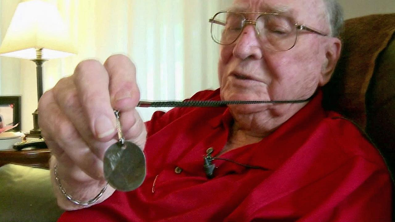 Jahue Mundy, 92, is reunited with his dog tags that vanished 67 years ago.