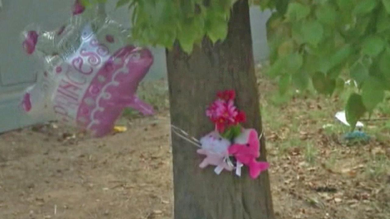 A makeshift memorial is shown near the site of a car crash that left a 6-year-old girl dead in Phoenix, Ariz. on Wednesday, Aug. 28, 2013.