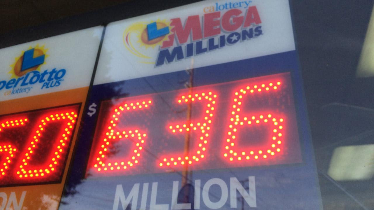 A Mega Millions jackpot sign is seen at a Highland Park store on Tuesday, Dec. 17, 2013.