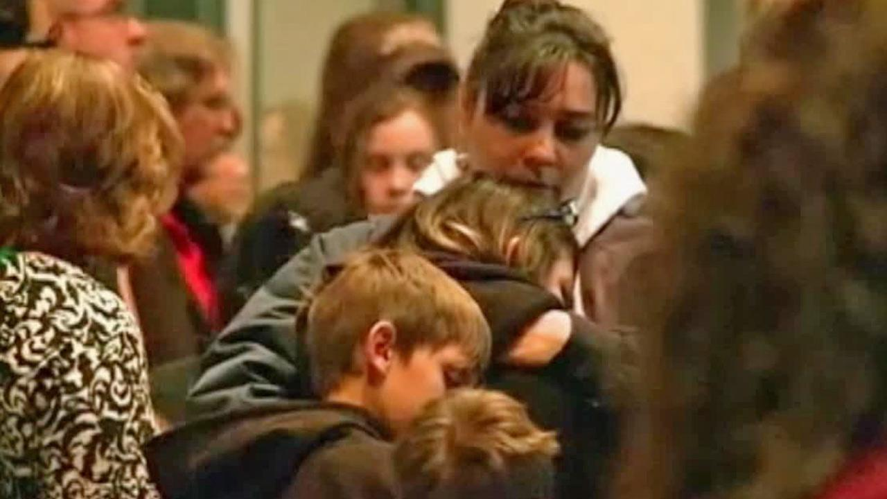 Parents and students gather at a vigil for victims of a shooting at a middle school in Roswell, N.M., on Tuesday, Jan. 14, 2014.