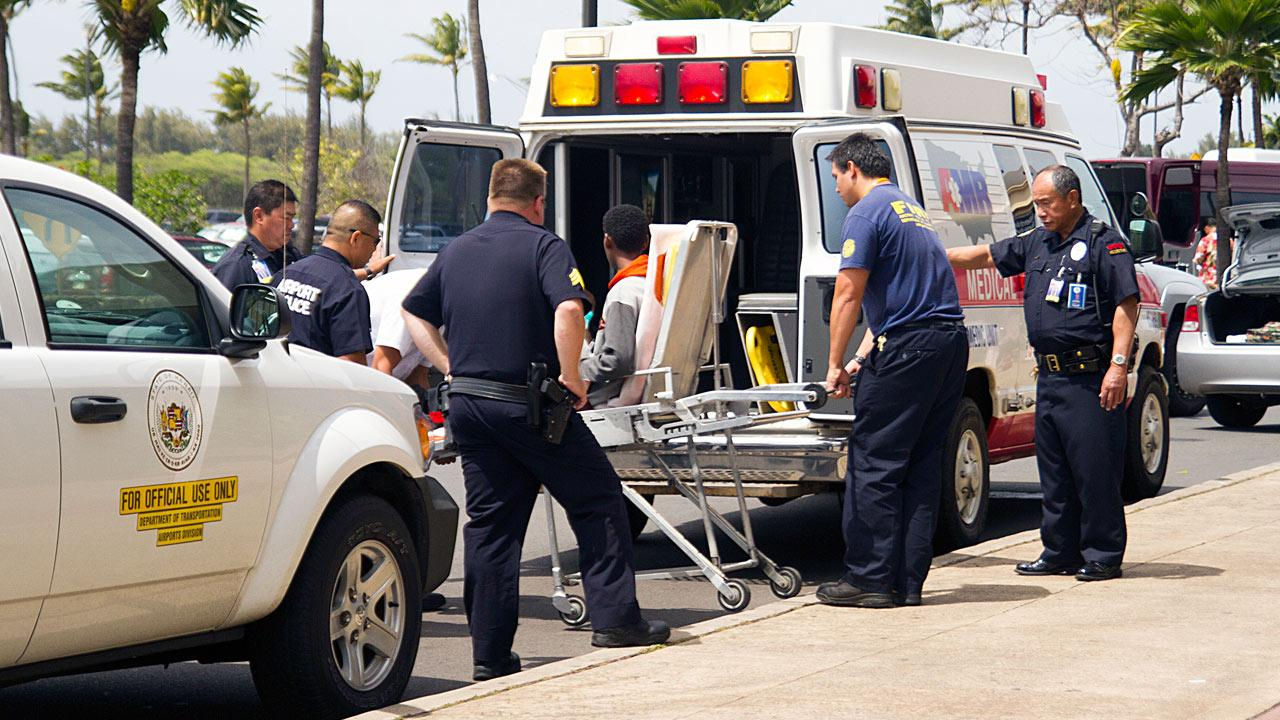 A teen boy is seen on a stretcher after FBI and airline officials said he survived a flight from California to Hawaii in a wheel well on Sunday, April 20, 2014.