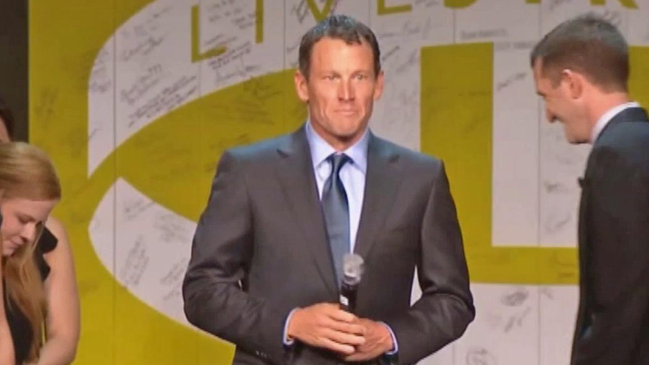 Lance Armstrong stands onstage during the 15th anniversary celebration for Livestrong, his cancer-fighting charity, on Friday, Oct. 19, 2012, in Austin, Tx.