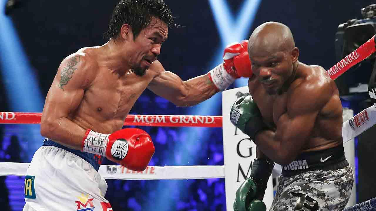 Manny Pacquiao, left, of the Philippines, drives Timothy Bradley into the ropes in their WBO welterweight title boxing bout Saturday, April 12, 2014, in Las Vegas. Pacquiao won by unanimous decision.