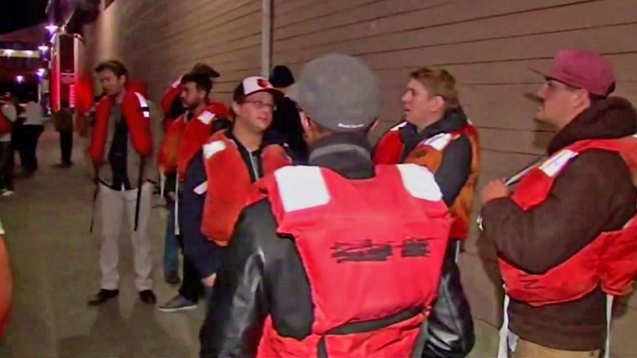 Nearly two dozen people, seen in life vests above, were rescued when their passenger boat in the San Francisco Bay began to sink on Friday, Oct. 12, 2012.