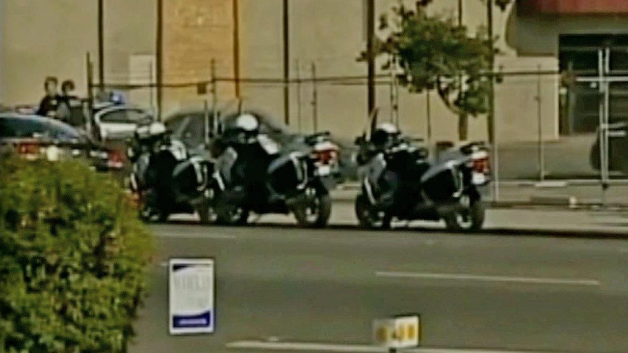 Law enforcement motorcycles are shown parked near the scene of a workplace shooting in Fresno on Tuesday, Nov. 6, 2012.