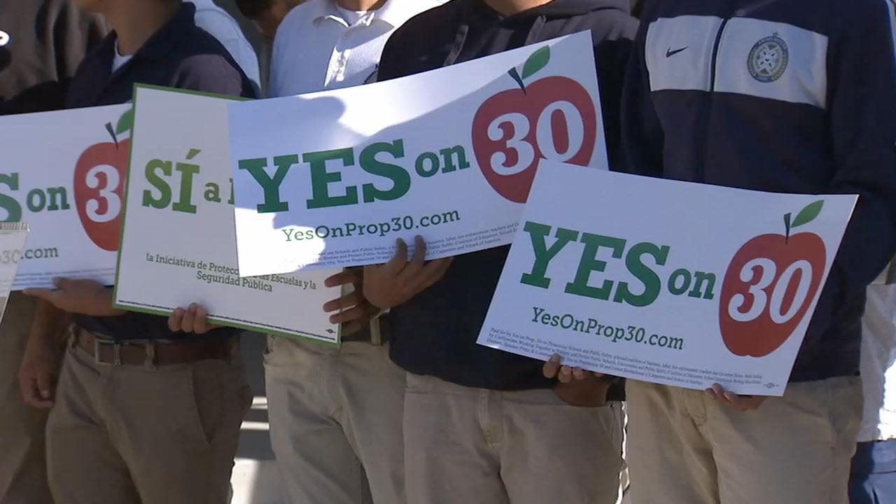 Public school students are seen holding up signs in support of Prop. 30 in this undated file photo.
