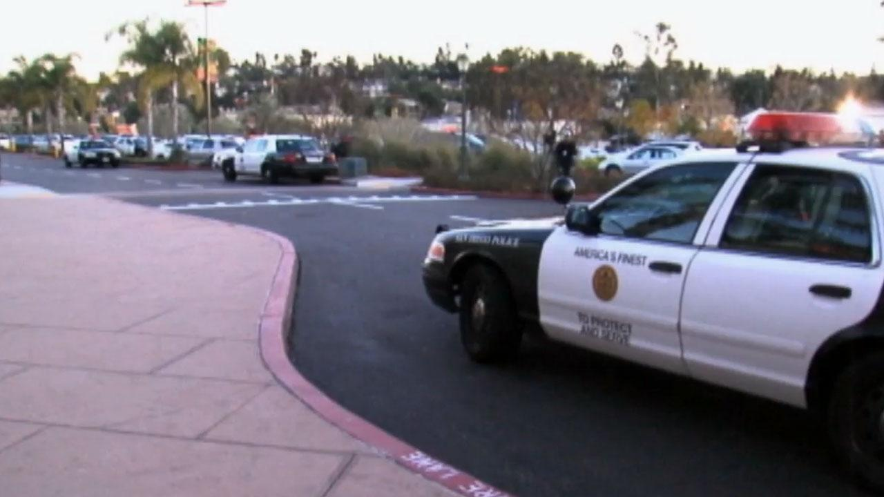 San Diego police respond to the scene of a movie theater shooting at Carmel Mountain Ranch movie theater on Saturday, Jan. 12, 2013.