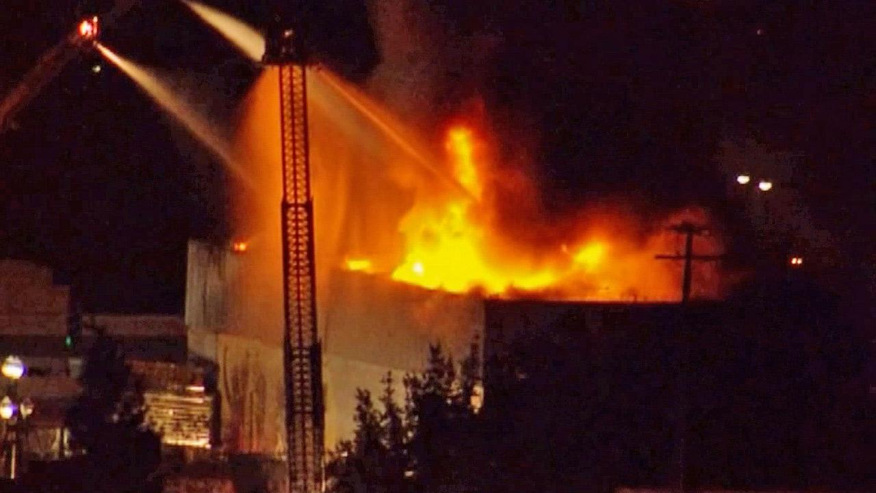 Fire crews douse the Original Pepperbelly Comedy and Variety Theater in Fairfield, Calif. on Friday, Jan. 25, 2013.