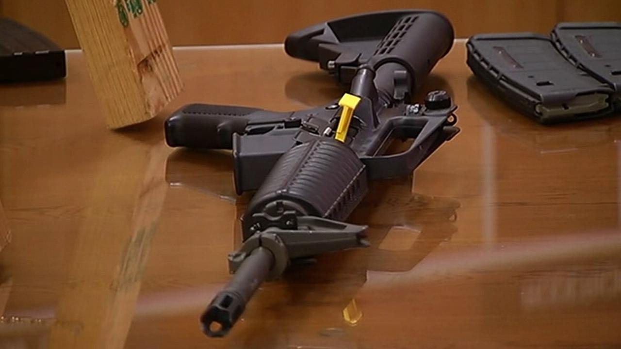 A weapon is seen at a gun control hearing in Sacramento on Tuesday, Jan. 29, 2013.
