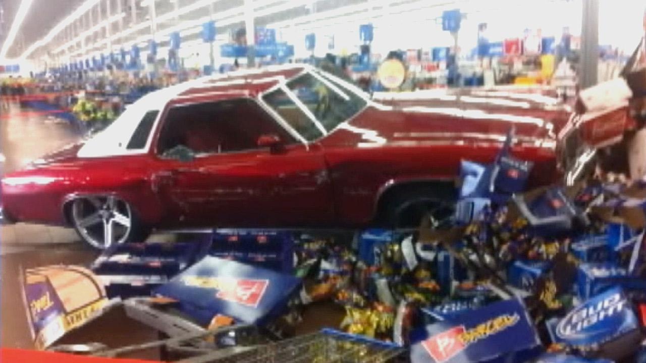 Police say a man who was bent on destruction rammed his car into a Wal-Mart in San Jose, then assaulted people inside on Sunday, March 31, 2013.
