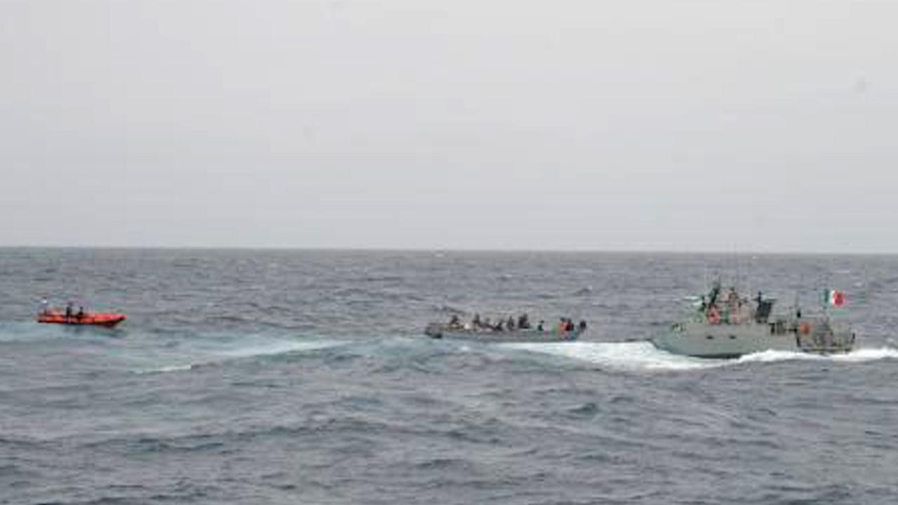 As a U.S. Coast Guard cutter stands by, the Mexican navy approaches a panga boat with three suspected drug smugglers and an estimated 250 bales of marijuana aboard south of San Diego Tuesday, June 18, 2013.