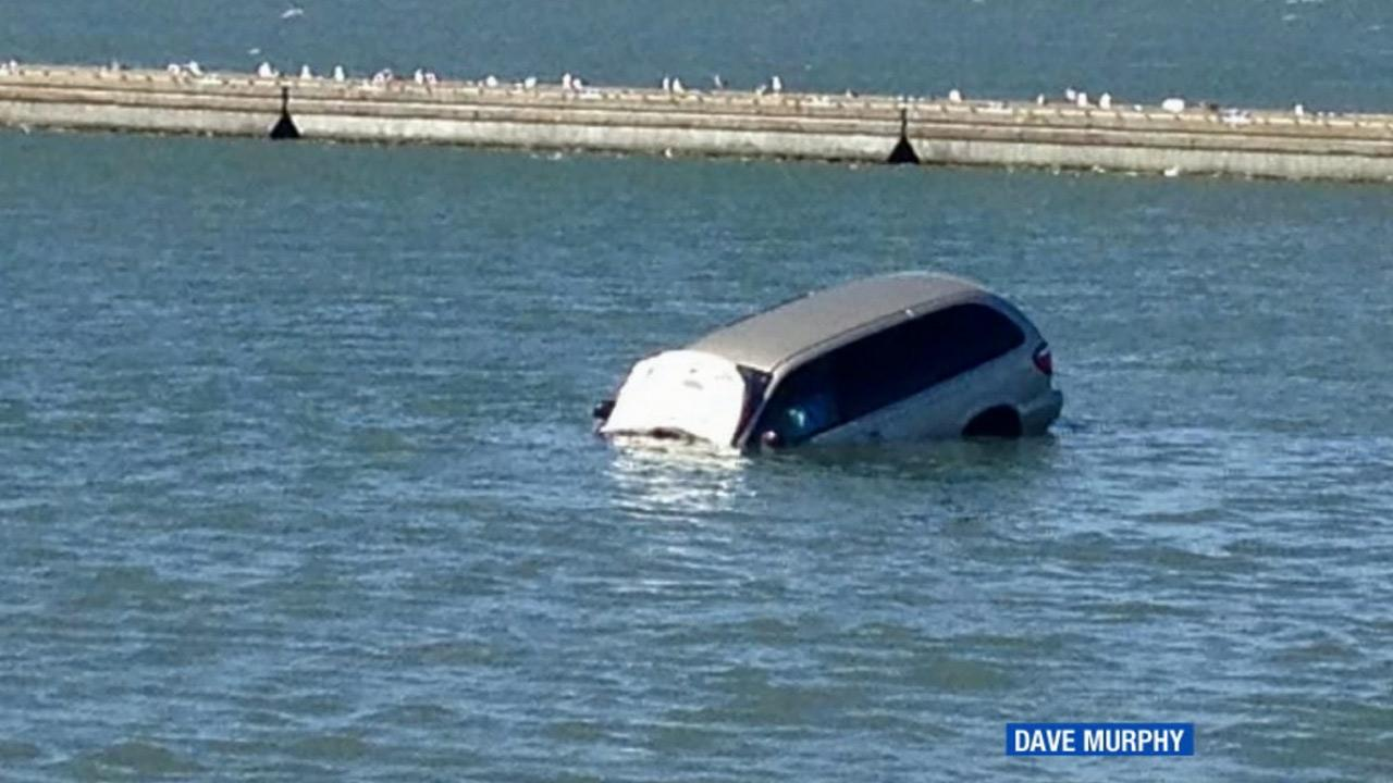 A van sinks in the San Francisco Bay after the driver drove the vehicle off a curb near the  San Francisco Marina Yacht Harbor on Friday, June 21, 2013.
