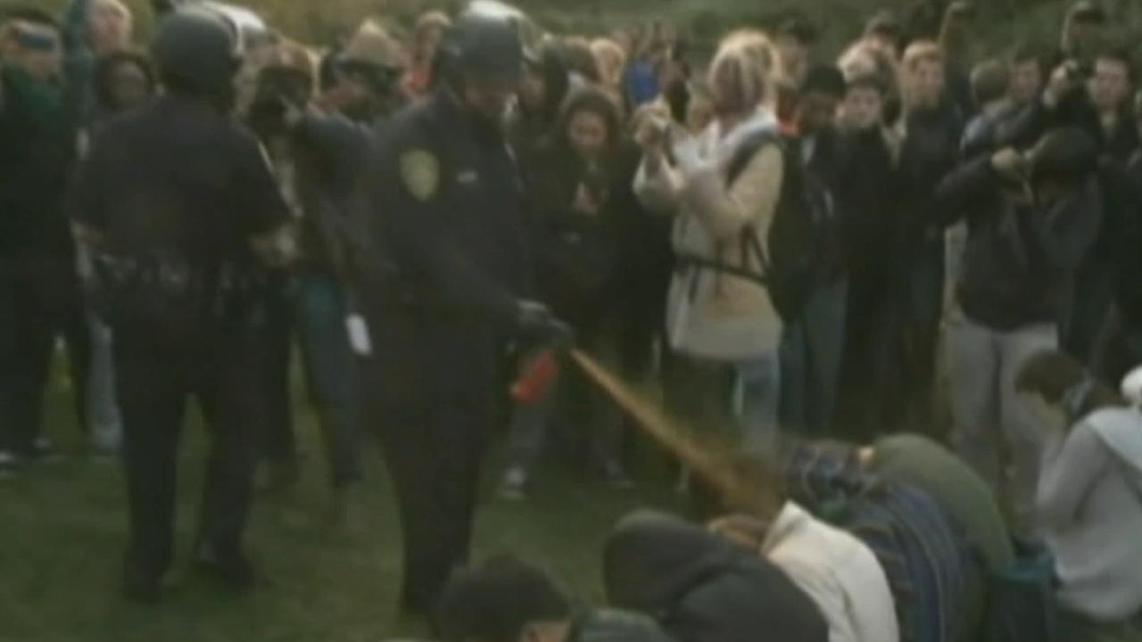 A police officer is seen pepper-spraying Occupy demonstrators at UC Davis in November 2011.
