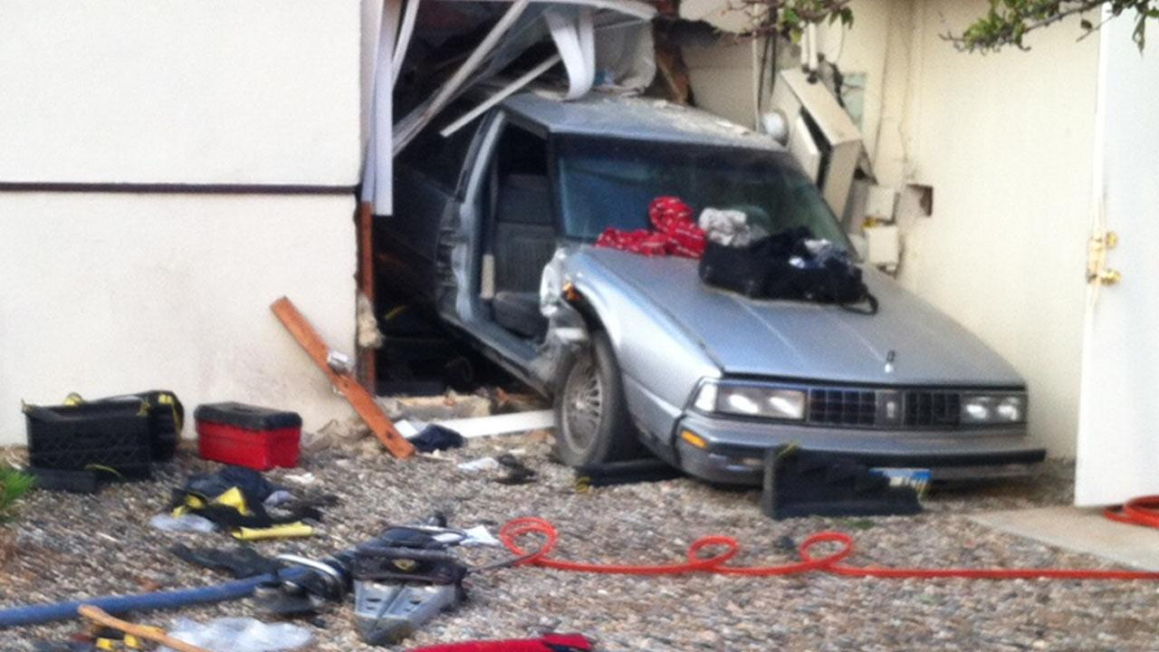 A car plowed into a home in Kern County, trapping an 11-year-old girl in her room, on Saturday, July 27, 2013. The girl and the driver were rescued with minimal injuries.