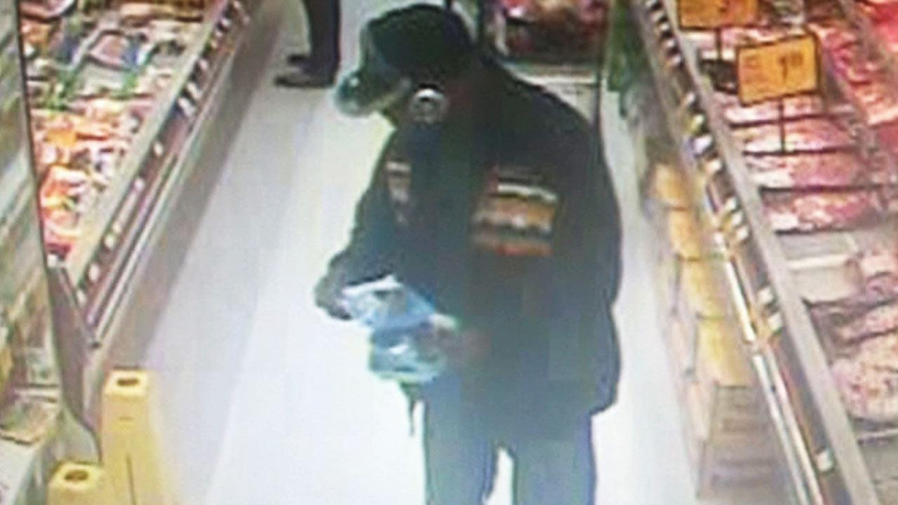 This surveillance still image shows a suspect wanted for a carjacking and kidnapping in Oakland, Calif. on Tuesday, Feb. 11, 2014.