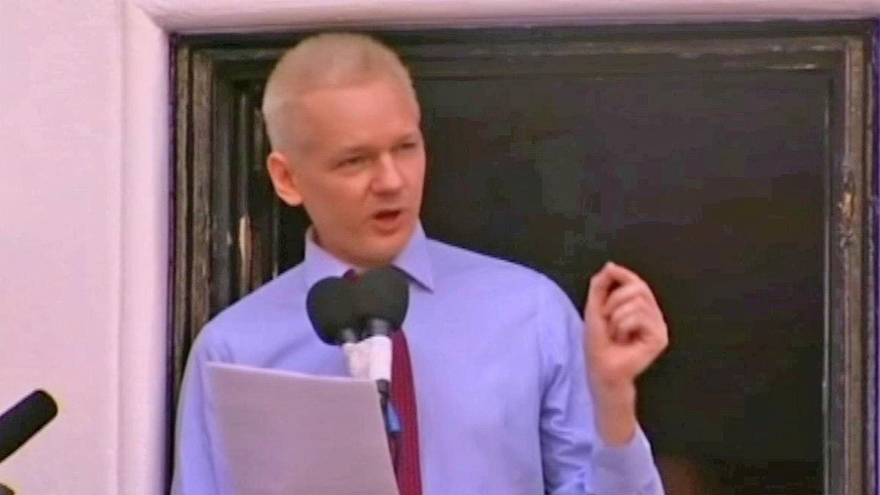 WikiLeaks founder Julian Assange makes a statement to the media and supporters at a window of Ecuadorian Embassy in central London, Sunday, Aug. 19, 2012.