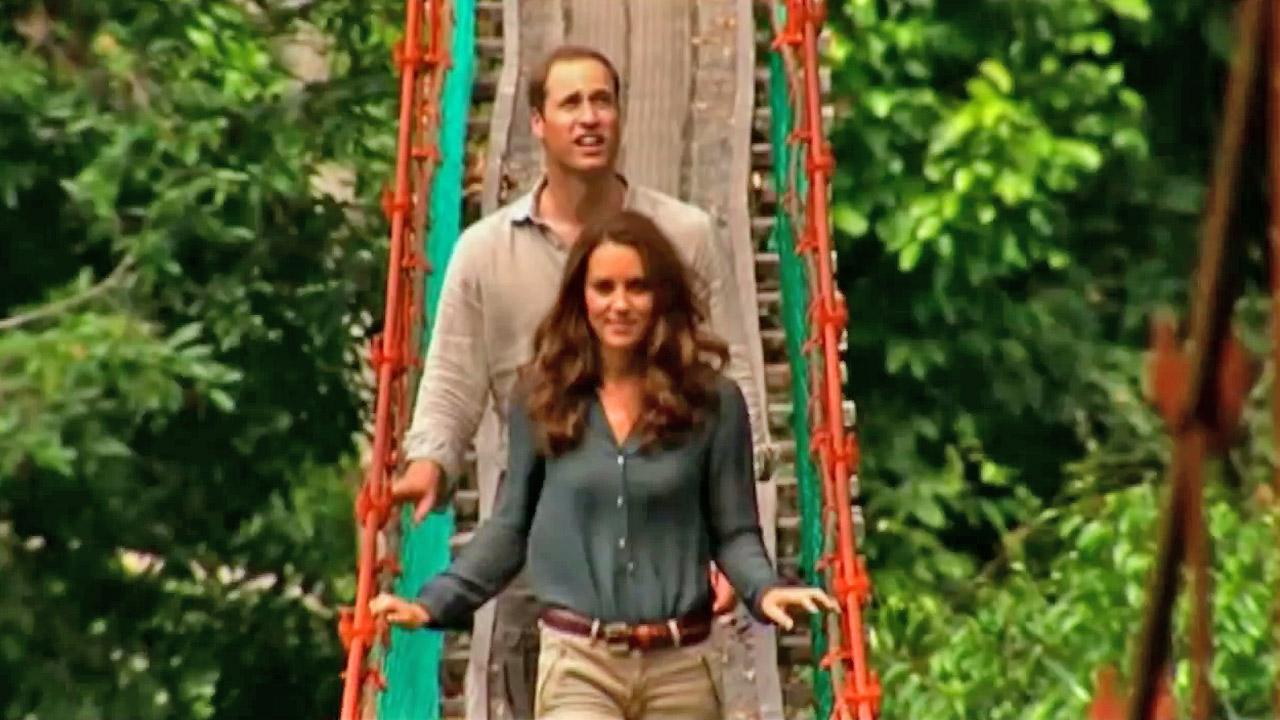 Prince William appears with his wife Kate as they walk through a bridge while touring Asia in the summer of 2012.