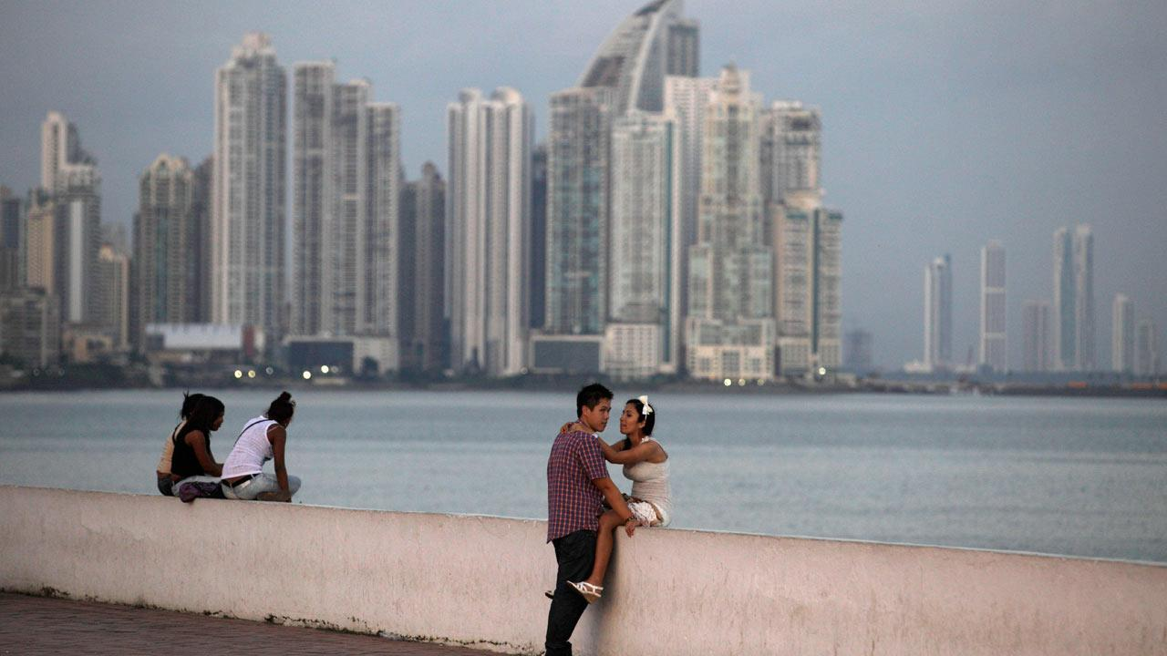 People watch the sunset from a waterfront site in Panama City, Wednesday, Dec. 19, 2012. A poll released Wednesday of nearly 150,000 people around the world says seven of the worlds 10 countries with the most upbeat attitudes are in Latin America.
