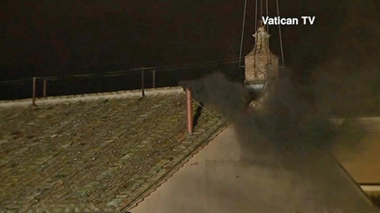 Black smoke emerges from the Sistine Chapel chimney Tuesday, March 12, 2013, to signal that a new pope has not yet been elected.