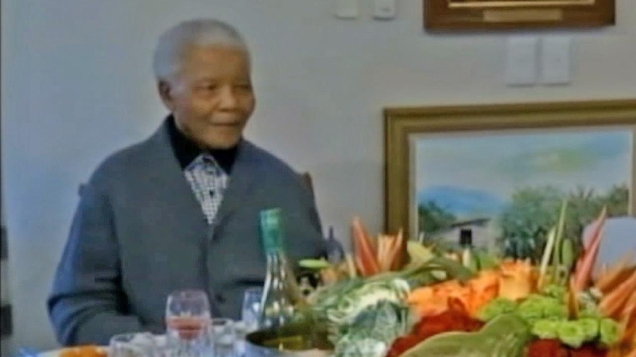 Nelson Mandela appears in this undated file photo.