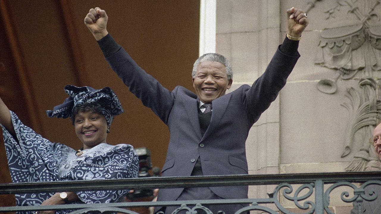Nelson Mandela, deputy leader of the African National Congress at the time, and his wife Winnie waving from a Strasbourgs Town Hall balcony Wednesday, June 13, 1990.