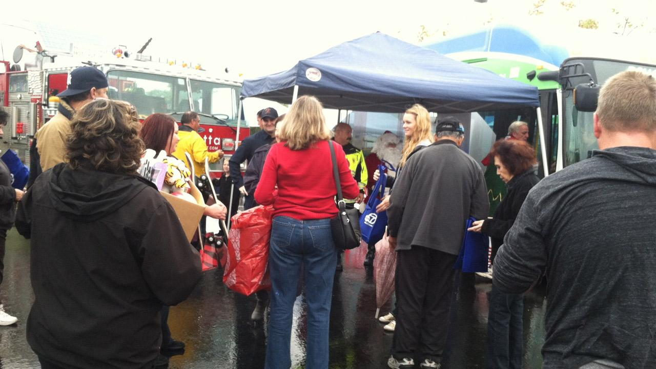 Crowd lines up to donate toys at the Stuff-A-Bus event at Mathis Brothers Furniture in Ontario on Friday, Nov. 30, 2012.