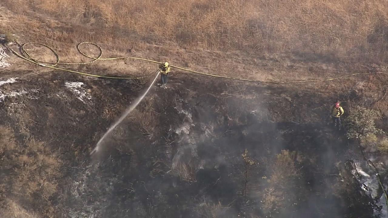 Fire crews make quick work of a small grass fire in Simi Valley on Tuesday, July 10, 2012.