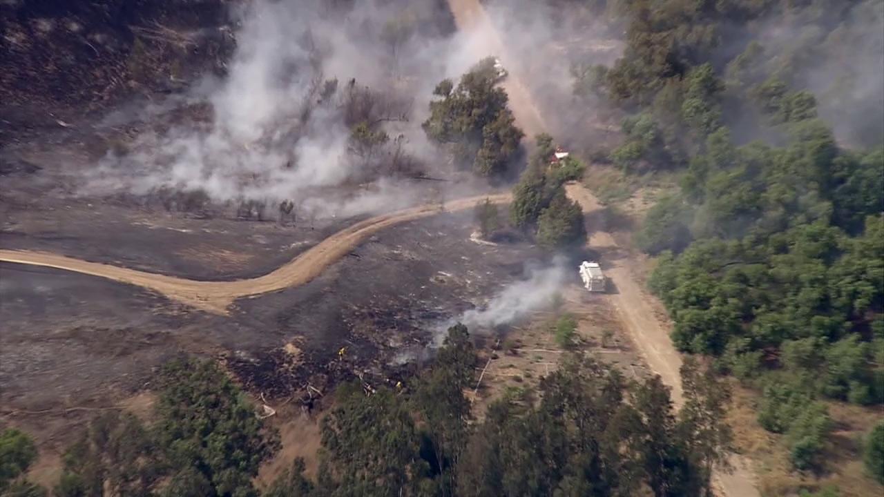 A grass fire erupted near Prado Regional Park in Chino on Wednesday, July 18, 2012.