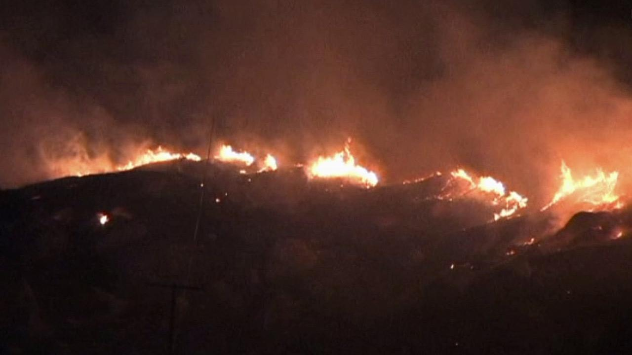 A brush fire burns at Blue Mountain Court and Pico Street in Grand Terrace on Tuesday, Aug. 21, 2012.
