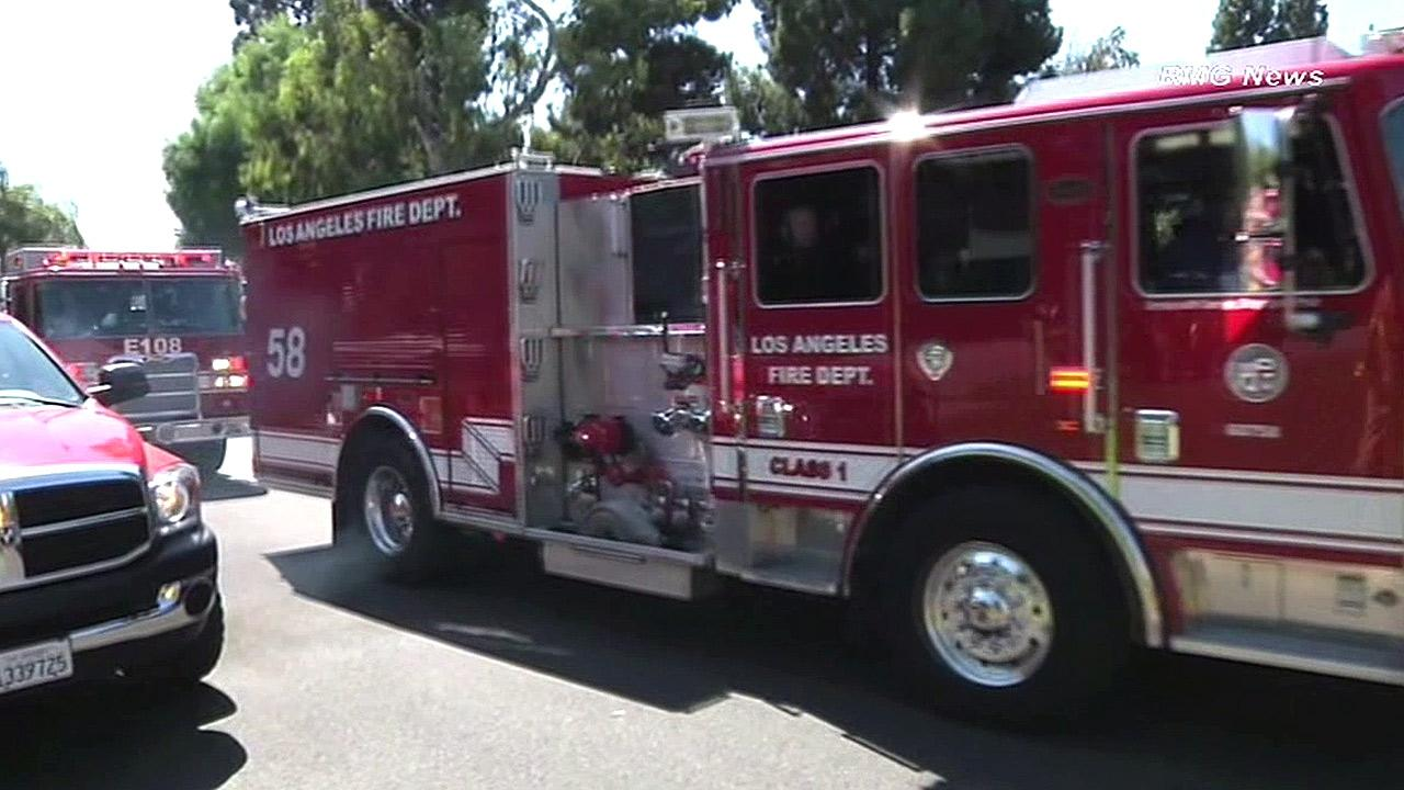 Fire engines are shown in the Brentwood area near the site of a brushfire that ignited on Saturday, Sept. 15, 2012.