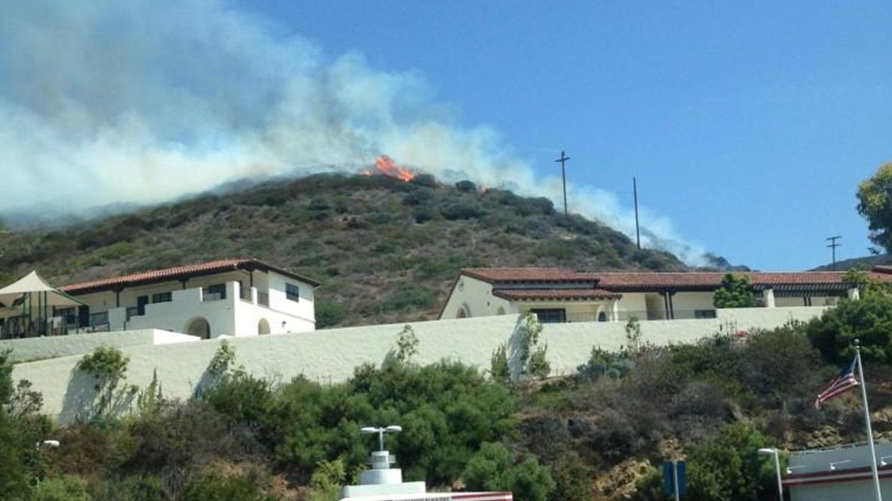 Eyewitness News viewer Jeffery Murray took this photo of flames and smoke from a brush fire in Laguna Beach near Nyes Place and Pacific Coast Highway that sparked around noon on Sunday, Sept. 16, 2012.