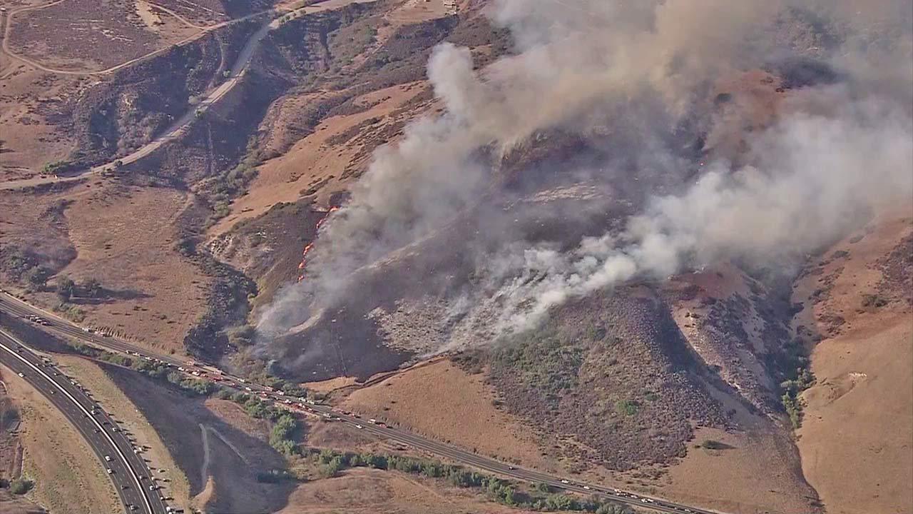 Brush fire burns near 241 Freeway, Chapman Avenue near city of Orange