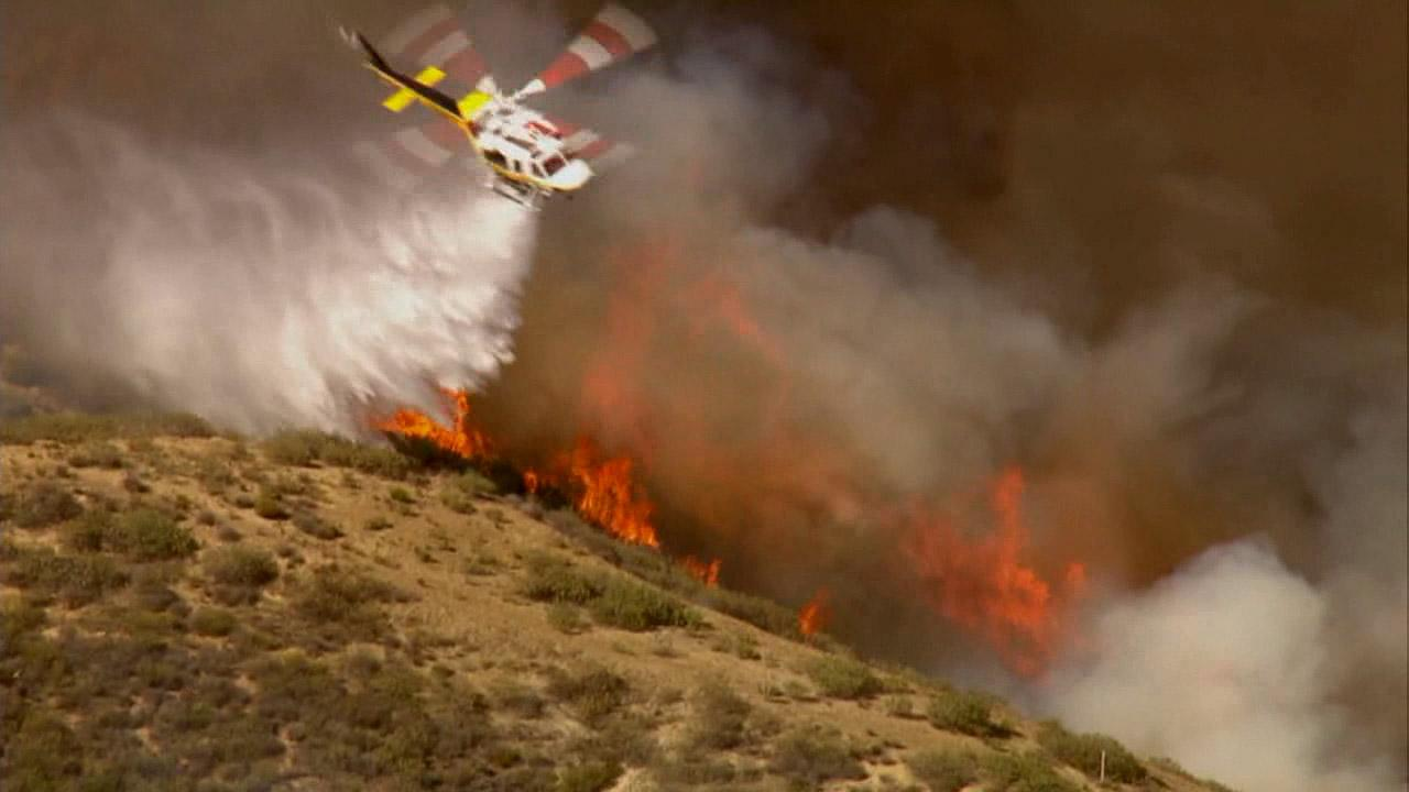 A brush fire erupted approximately 10 miles north of Castaic Lake next to the 5 Freeway Monday, May 13, 2013.