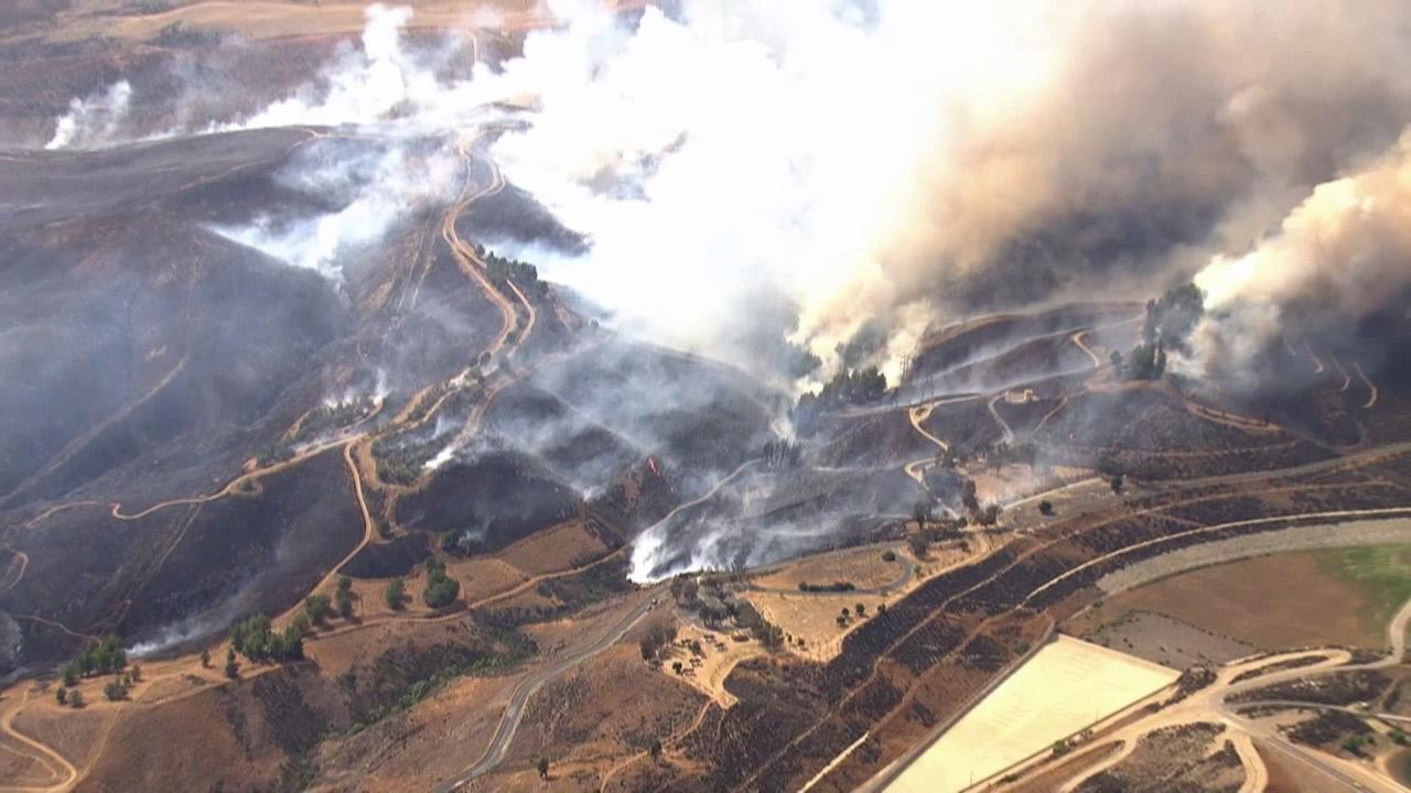 Smoke from a brush fire burning in the Castaic area is seen from AIR7 HD on Friday, May 17, 2013.