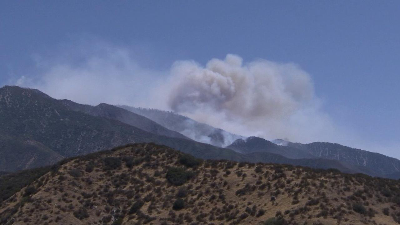 The Hathaway Fire burning in the northern portion of the Morongo Reservation area in Riverside County sends smoke billowing into the air on Monday, June 10, 2013.