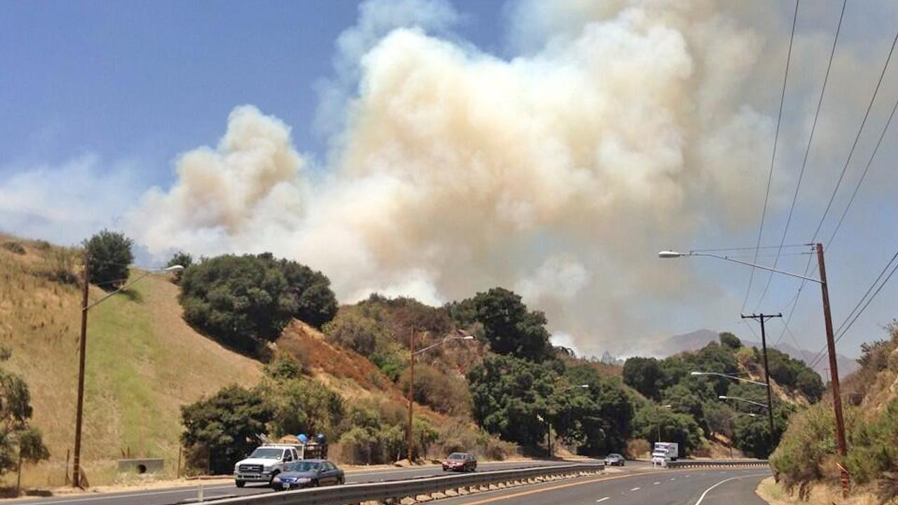 ABC7 viewer Rick McClure took this photo of smoke from a wild fire in the Newhall Pass between the Calgrove exit and the State Route 14 junction on Saturday, June 22, 2013.