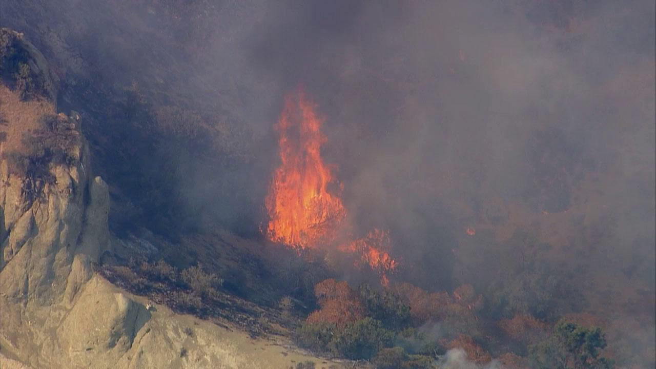 Firefighters were battling a fire near the southbound 5 Freeway and Fort Tejon in the Kern County town of Lebec on Saturday, July 20, 2013.