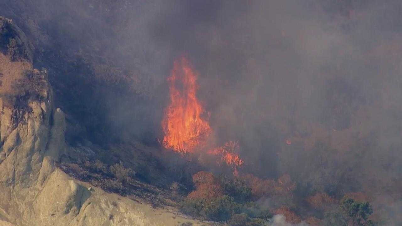 Firefighters were battling a fire near the southbound 5 Freeway and Fort Tejon in the Kern County town of Lebec on Sunday, July 21, 2013.