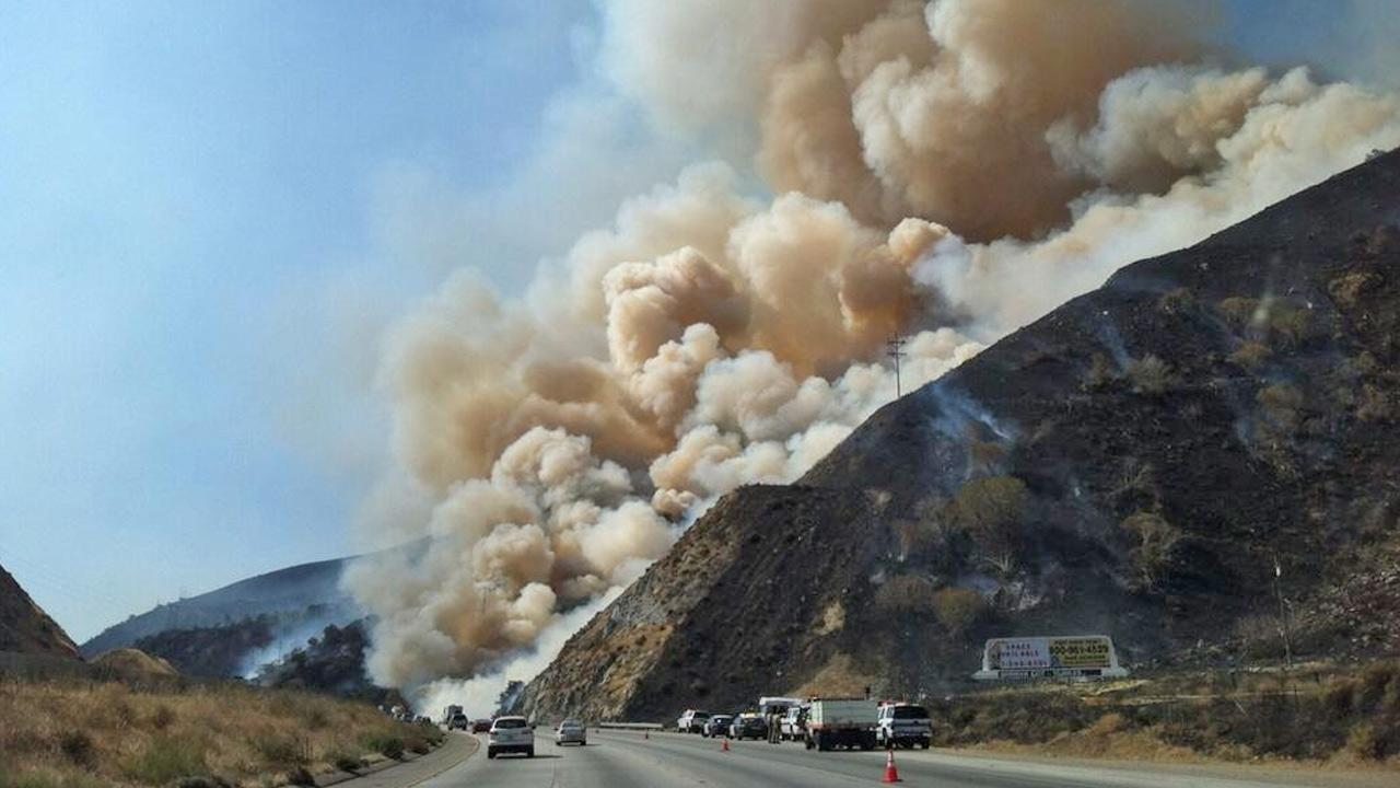 A wildfire burning in Kern County is seen from the 5 Freeway in this photo taken on Tuesday, July 23, 2013.