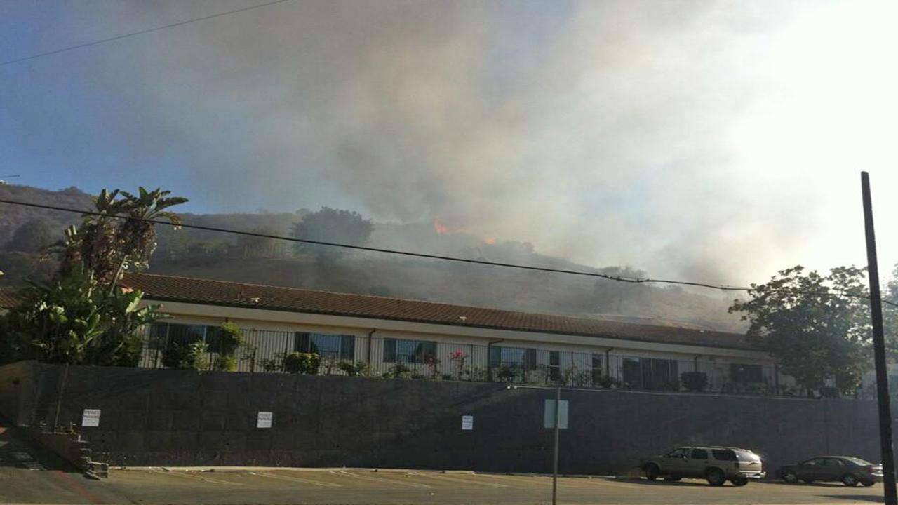 A brush fire burns near 10077 Sunland Boulevard in the Sunland area on Sunday, Sept. 15, 2013.