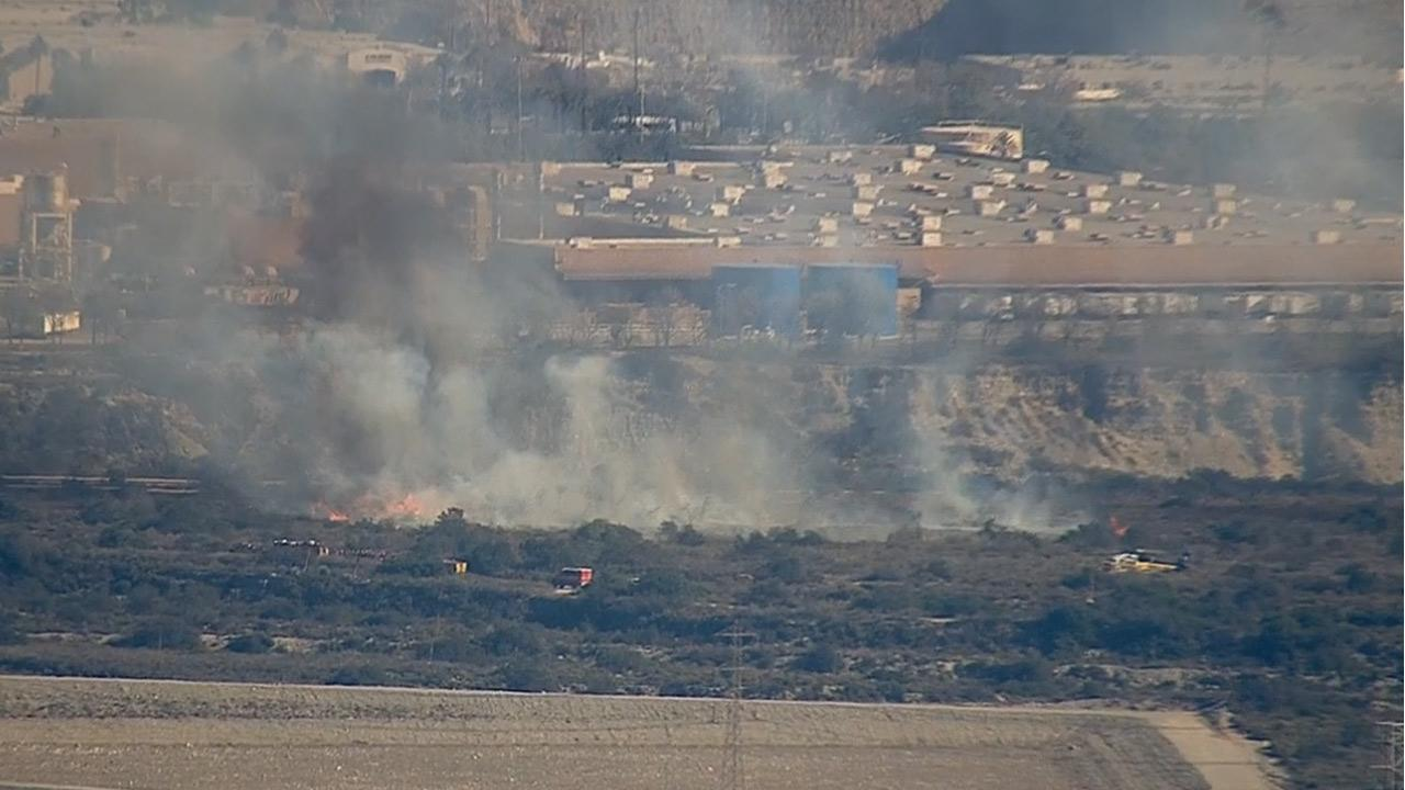A brush fire broke out near the 210 Freeway at Irwindale Avenue in Irwindale Monday, Dec. 30, 2013.