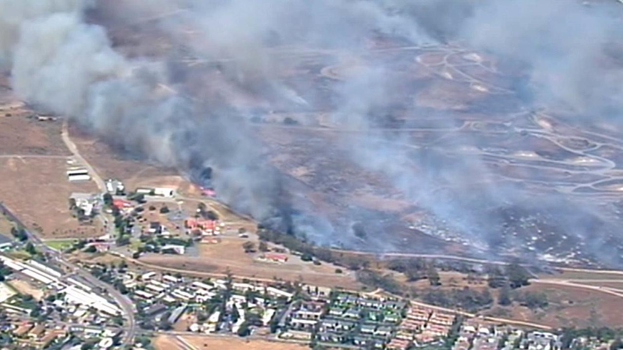 A brush fire burns at Camp Pendleton on the southeast side of the base near Fallbrook on Wednesday, May 14, 2014.