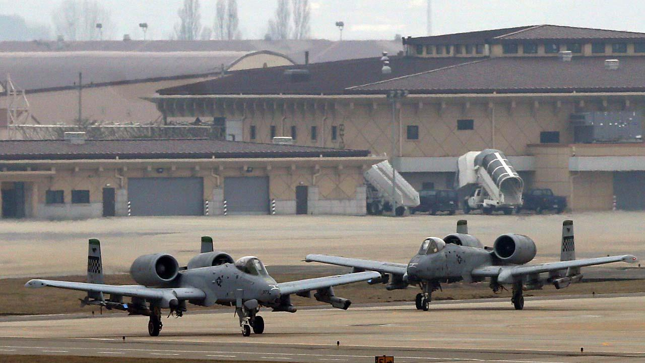 U.S. Air Force A-10 attack aircrafts wait to take off on the runway during their military exercise at the Osan U.S. Air Base in Pyeongtaek, south of Seoul, South Korea