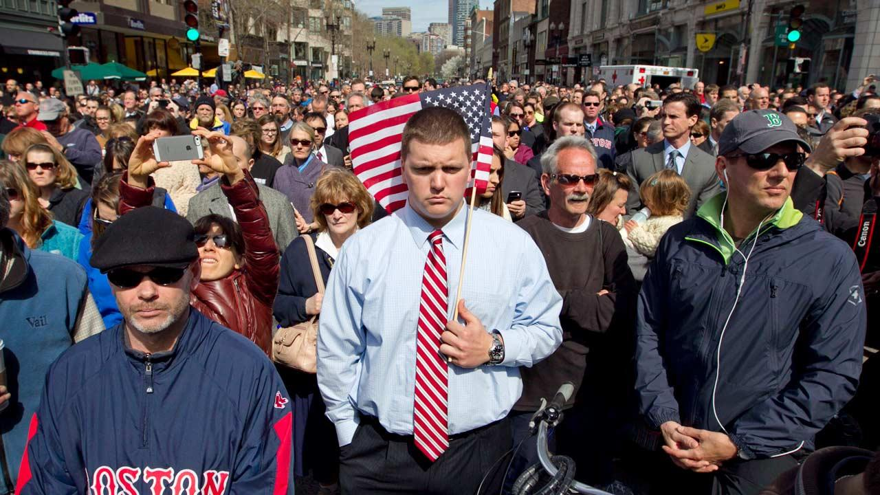 A moment of silence in honor of the victims of the Boston Marathon bombing is observed on Boylston Street near the race finish line, exactly one week after the tragedy, Monday, April 22, 2013, in Boston, Mass.